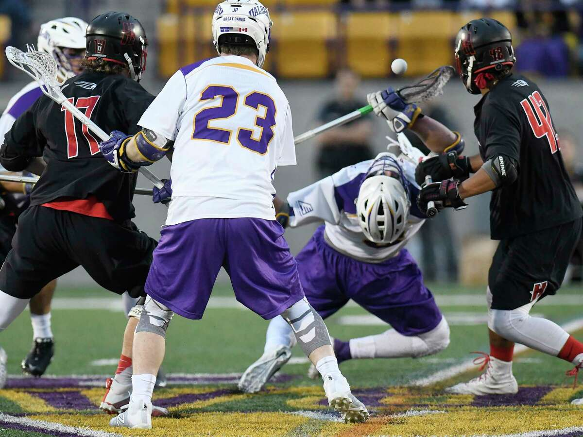 UAlbany's TD Ierlan ,third from left, wins a face-off against Hartford during a NCAA Division I college men's lacrosse game on Saturday, April 29, 2017, in Albany, N.Y. (Hans Pennink / Special to the Times Union) ORG XMIT: HP102