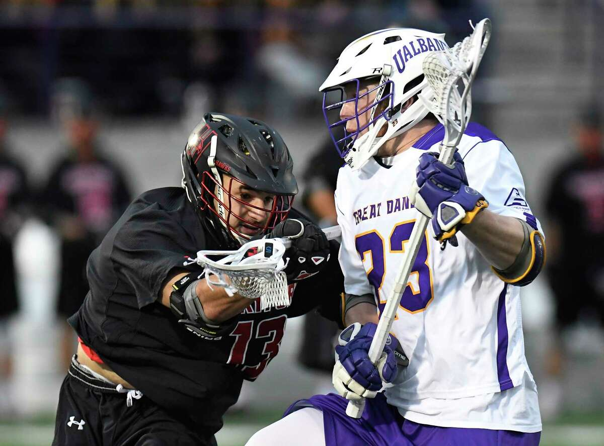 Hartford's Zach Elkinson (13) defends against UAlbany's Jack Burgmaster (23) during a NCAA Division I college men's lacrosse game on Saturday, April 29, 2017, in Albany, N.Y. (Hans Pennink / Special to the Times Union) ORG XMIT: HP103