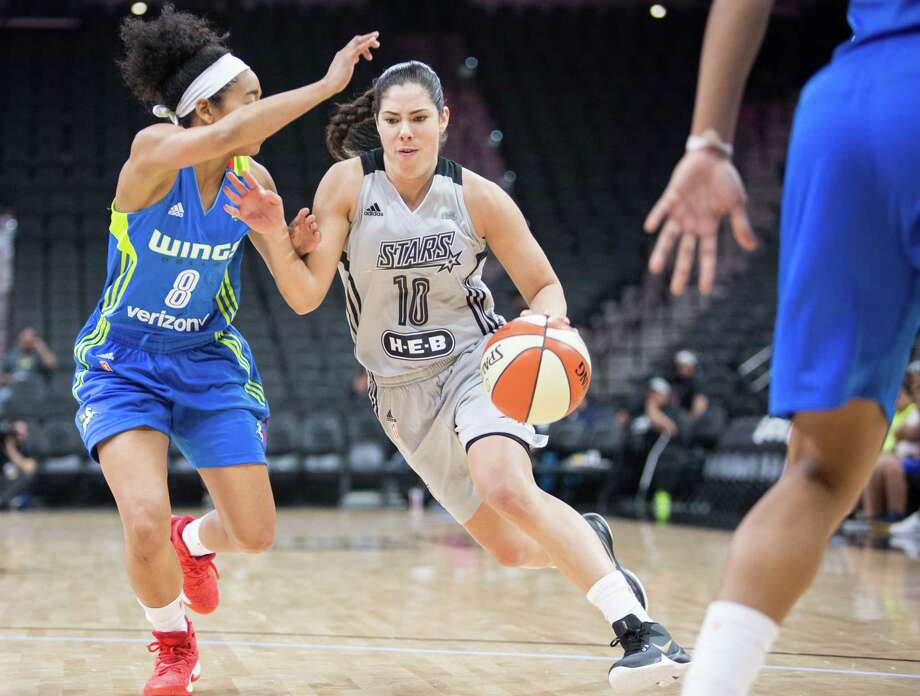 Kelsey Plum of the Stars drives to the basket during a WNBA preseason game against the Dallas Wings at the AT&T Center in San Antonio on April 29, 2017. Photo: Federica Valabrega /For The Express-News / © Federica Valabrega