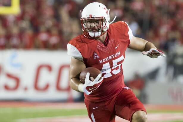 Houston Cougars' tight end Tyler McCloskey (45) catches a short pass and is tackled near the endzone in the second quarter of a NCAA college football game at TDECU Stadium on Saturday, September 26, 2015, in Houston. ( Joe Buvid / For the Chronicle )