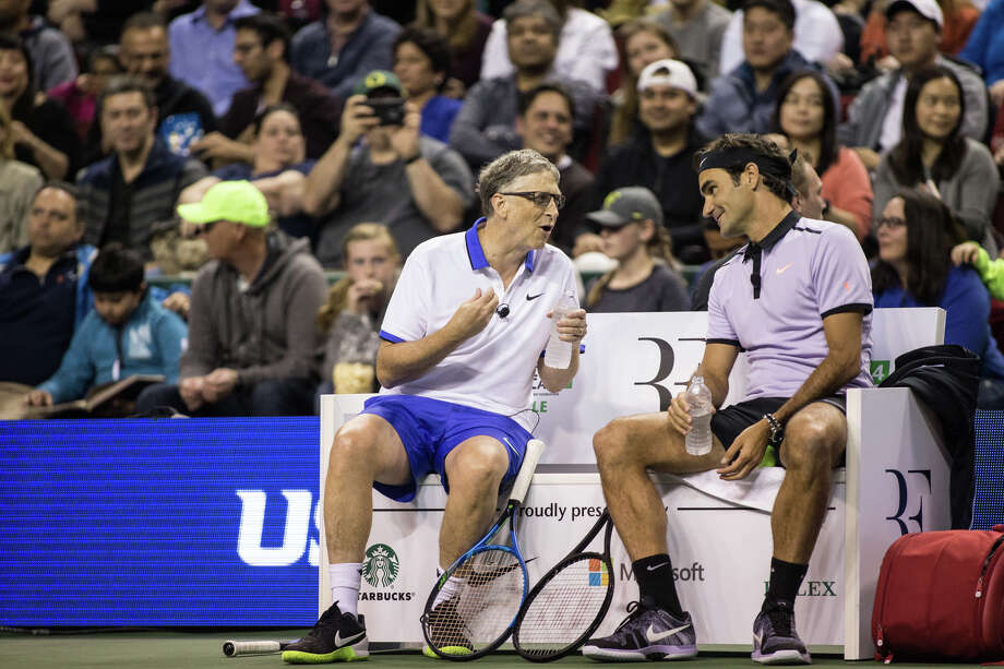 Bill Gates and Roger Federer converse between games during The Match for Africa 4 at KeyArena on Saturday, April 29, 2017. Proceeds of the match benefit the Roger Federer Foundation and its projects to help children in poverty. Photo: GRANT HINDSLEY, SEATTLEPI.COM / SEATTLEPI.COM