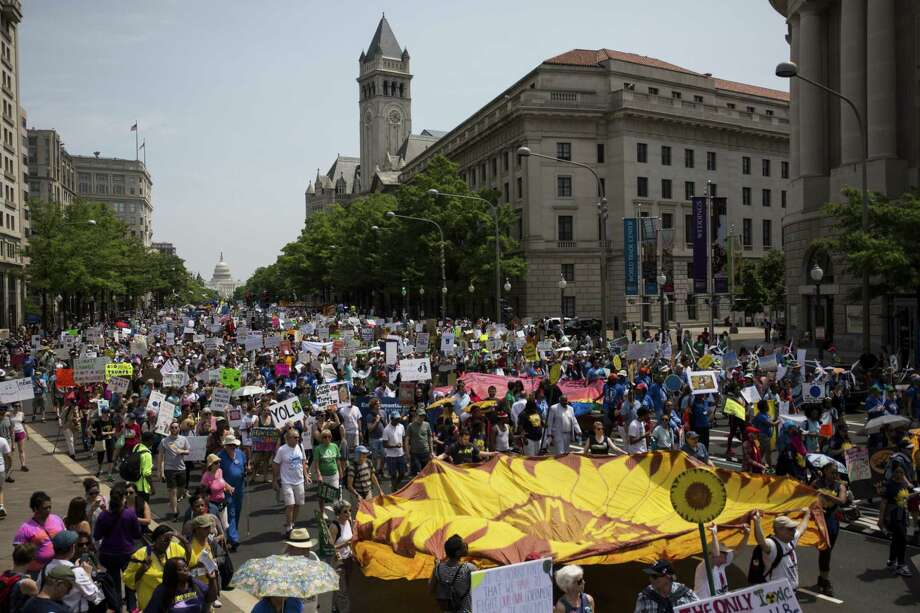 Demonstrators march down Pennsylvania Avenue during the People's Climate Movement March in Washington, D.C., U.S., on Saturday, April 29, 2017. Coinciding with U.S. President Donald Trump's 100th day in office, the People's Climate Movement March seeks to bring attention to and strengthen climate reform in the context of the Trump Administration cuts to environmental policy. Photographer: Zach Gibson/Bloomberg ORG XMIT: 700042352 Photo: Zach Gibson / © 2017 Bloomberg Finance LP