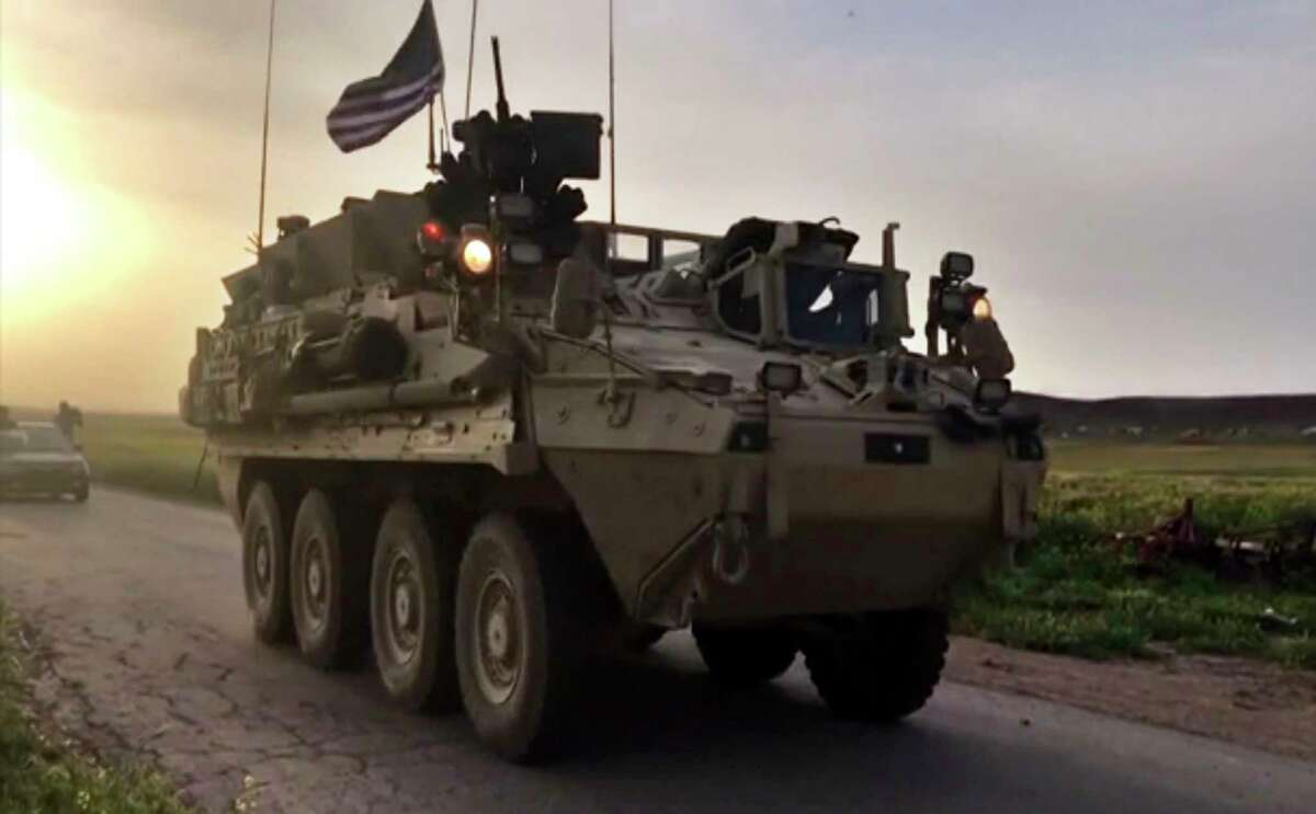 This Friday, April 28, 2017 still taken from video, shows U.S. forces patrolling on a rural road in the village of Darbasiyah, in northern Syria. U.S. armored vehicles are deploying in areas in northern Syria along the tense border with Turkey, a few days after a Turkish airstrike that killed 20 U.S.-backed Kurdish fighters, a Syrian war monitor and Kurdish activists said Friday. (AP Photo via APTV) ORG XMIT: BEI102