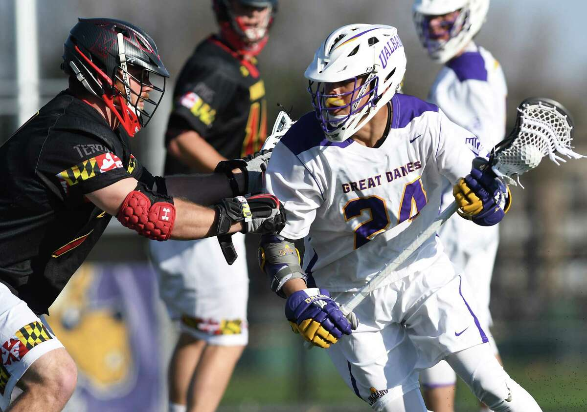 University at Albany's Jakob Patterson, right, is defended by Maryland's Tim Rotanz during a lacrosse game on Wednesday, April 12, 2017 in Albany, N.Y. (Lori Van Buren / Times Union)