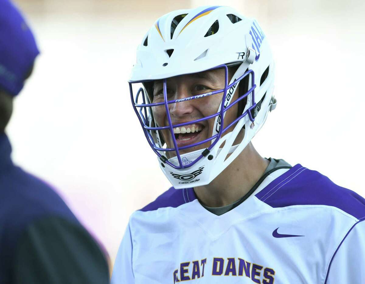 University at Albany's Ky Tarbell laughs with someone on the sideline during a lacrosse game against Maryland on Wednesday, April 12, 2017 in Albany, N.Y. (Lori Van Buren / Times Union)