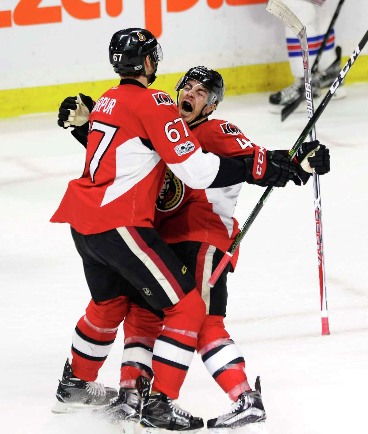 Ottawa Senators center Jean-Gabriel Pageau (44) celebrates his goal with defenseman Ben Harpur (67)during the first period in Game 2 against the New York Rangers in the second-round of the NHL hockey Stanley Cup playoffs Saturday, April 29, 2017, in Ottawa. (Adrian Wyld/The Canadian Press via AP) ORG XMIT: JFJ506