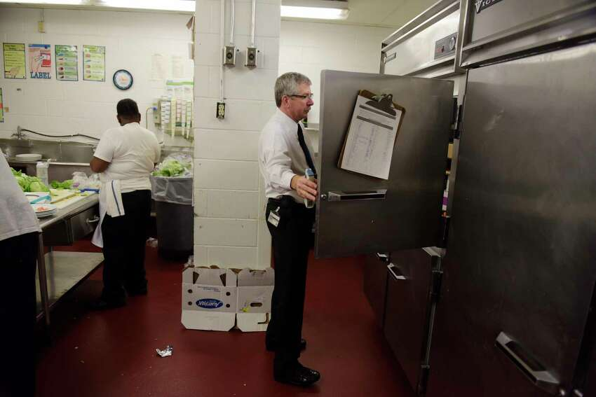 Douglas Hosterman, a senior public health technician with Albany County Department of Health, checks a cooler as he conducts an inspection of the kitchen at the Albany Marriott on Tuesday, April 25, 2017, in Colonie, N.Y. (Paul Buckowski / Times Union)