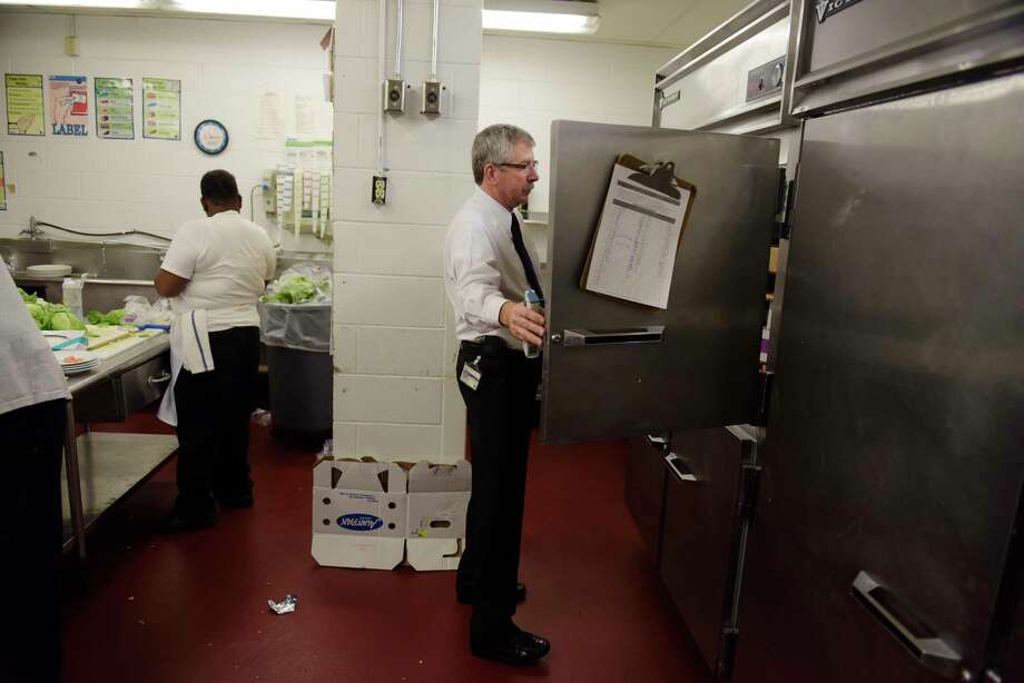 Douglas Hosterman, a senior public health technician with Albany County Department of Health, checks a cooler as he conducts an inspection of the kitchen at the Albany Marriott on Tuesday, April 25, 2017, in Colonie, N.Y.  (Paul Buckowski / Times Union) Photo: PAUL BUCKOWSKI / 20040340A