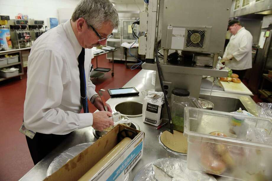 Douglas Hosterman, a senior public health technician with Albany County Department of Health, checks the temperature of soup as he conducts an inspection of the kitchen at the Albany Marriott on Tuesday, April 25, 2017, in Colonie, N.Y.  (Paul Buckowski / Times Union) Photo: PAUL BUCKOWSKI / 20040340A