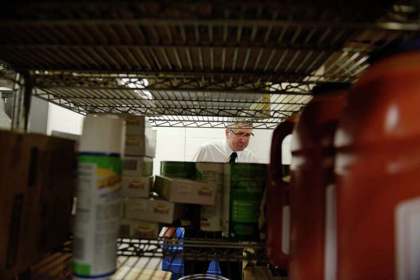 Douglas Hosterman, a senior public health technician with Albany County Department of Health, looks over the stock room as he conducts an inspection of the kitchen at the Albany Marriott on Tuesday, April 25, 2017, in Colonie, N.Y. (Paul Buckowski / Times Union)