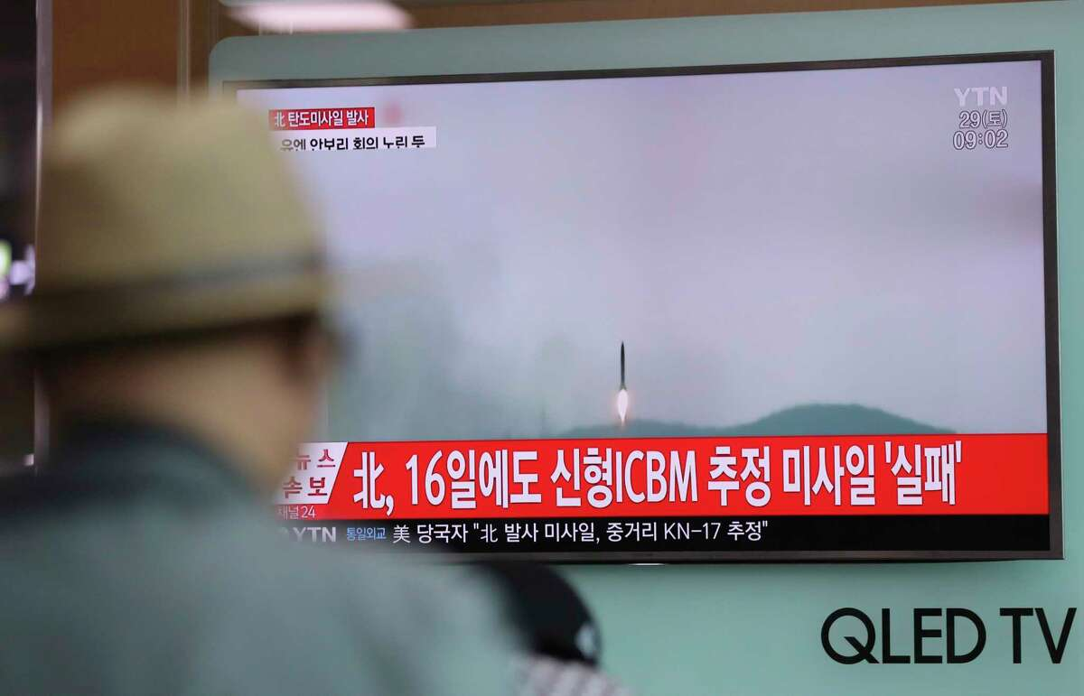 A man watches a TV news program reporting about North Korea's missile firing with a file footage, at Seoul Train Station in Seoul, South Korea, Saturday, April 29, 2017. A North Korean mid-range ballistic missile apparently failed shortly after launch Saturday, South Korea and the United States said, the second such test-fire flop in recent weeks but a clear message of defiance as a U.S. supercarrier conducts drills in nearby waters. The letters on top left, reading