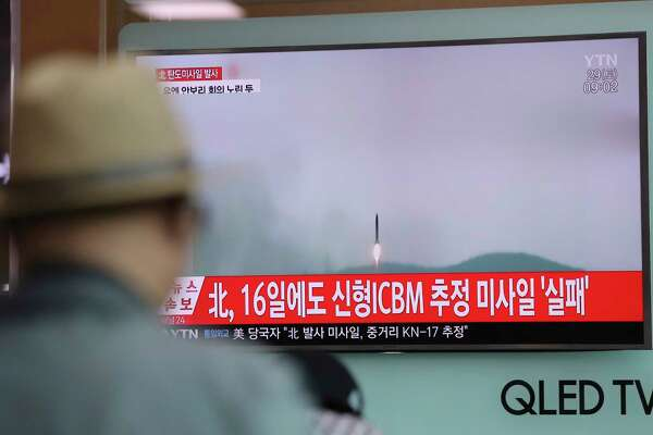 "A man watches a TV news program reporting about North Korea's missile firing with a file footage, at Seoul Train Station in Seoul, South Korea, Saturday, April 29, 2017. A North Korean mid-range ballistic missile apparently failed shortly after launch Saturday, South Korea and the United States said, the second such test-fire flop in recent weeks but a clear message of defiance as a U.S. supercarrier conducts drills in nearby waters. The letters on top left, reading ""North Korea fired a ballistic missile."" (AP Photo/Lee Jin-man) ORG XMIT: LJM101"