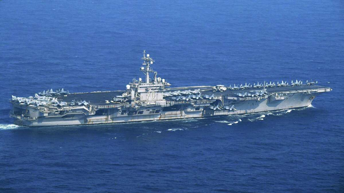 The USS Carl Vinson sails offshore Nagasaki prefecture, southern Japan Saturday, April 29, 2017. The USS Carl Vinson is heading north toward the Korean peninsula in a show of force after satellite images suggested North Korea may be preparing to conduct a nuclear test. A North Korean mid-range ballistic missile apparently failed shortly after launch Saturday, South Korea and the United States said, the third test-fire flop just this month but a clear message of defiance as a U.S. supercarrier conducts drills in nearby waters. (Kyodo News via AP) ORG XMIT: TKMY804