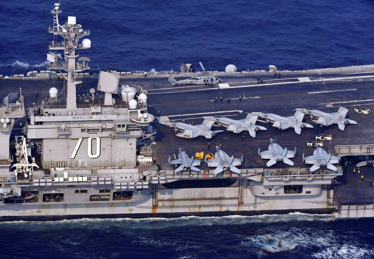 The USS Carl Vinson sails offshore Nagasaki prefecture, southern Japan Saturday, April 29, 2017. The USS Carl Vinson is heading north toward the Korean peninsula in a show of force after satellite images suggested North Korea may be preparing to conduct a nuclear test. A North Korean mid-range ballistic missile apparently failed shortly after launch Saturday, South Korea and the United States said, the third test-fire flop just this month but a clear message of defiance as a U.S. supercarrier conducts drills in nearby waters. (Kyodo News via AP) ORG XMIT: TKMY805