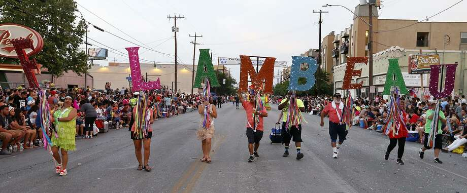 A group carries the Fiesta Flambeau Letters during the 2017 Fiesta Flambeau Parade April 29. Photo: Edward A. Ornelas /San Antonio Express-News / © 2017 San Antonio Express-News