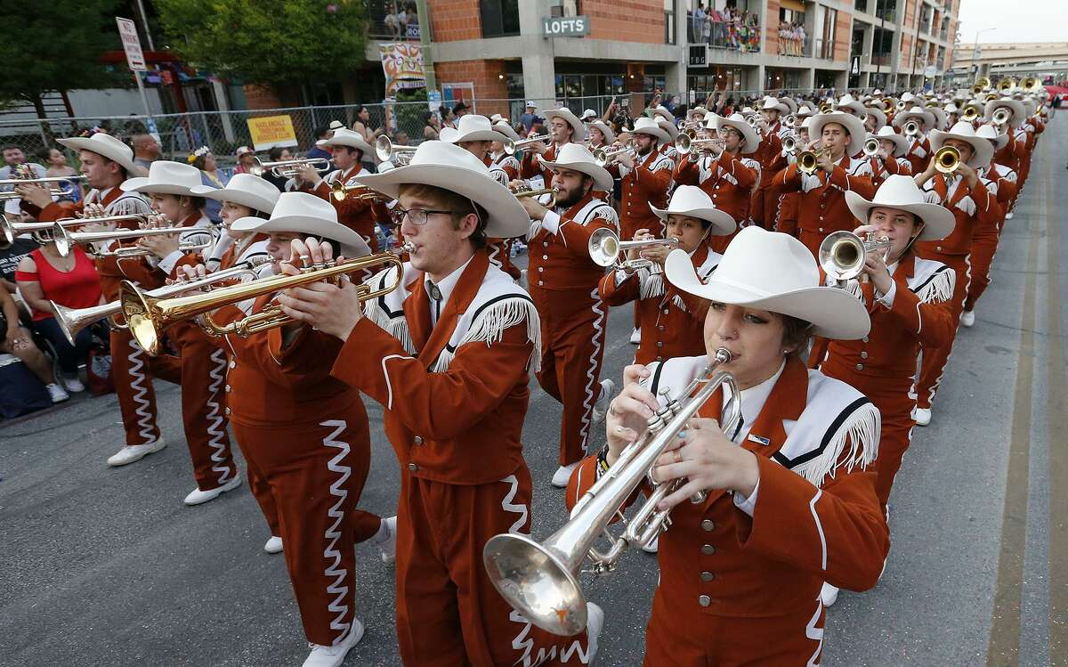 """The University of Texas Longhorn Band performed during the 2017 Fiesta Flambeau Parade April 29. The school song, """"The Eyes of Texas,"""" is always a crowd favorite, and was penned by a student from San Antonio in 1903."""
