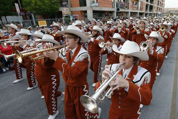 "The University of Texas Longhorn Band performed during the 2017 Fiesta Flambeau Parade April 29. The school song, ""The Eyes of Texas,"" is always a crowd favorite, and was penned by a student from San Antonio in 1903."