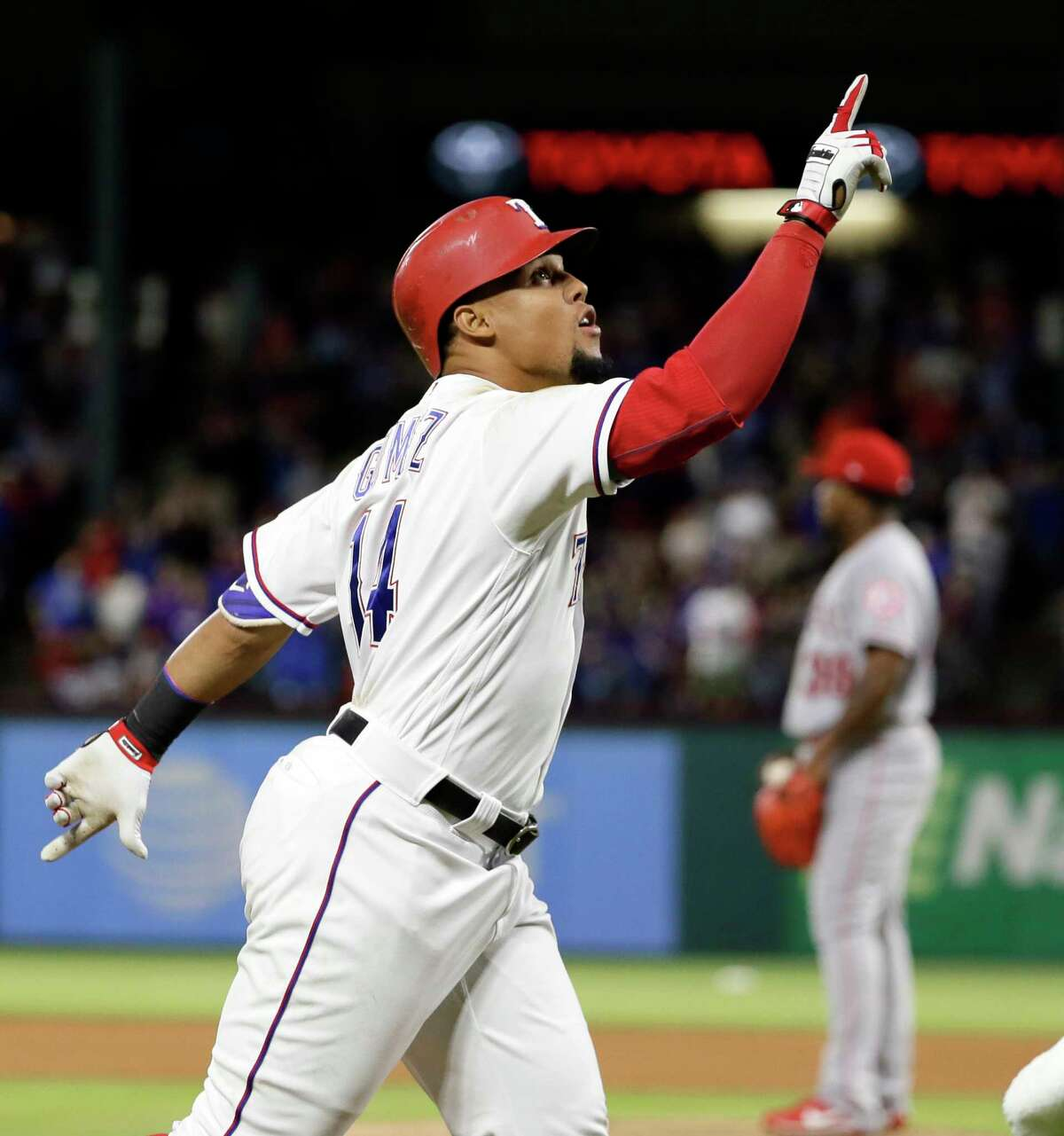 Texas Rangers' Carlos Gomez points skyward as he approaches the plate after hitting a two-run home run off of Los Angeles Angels relief pitcher Jose Valdez, rear, during the seventh inning of a baseball game in Arlington, Texas, Saturday, April 29, 2017. Gomez hit for the cycle. (AP Photo/Tony Gutierrez) ORG XMIT: ARL117
