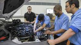 Students take part at BMWs technician training center in Woodcliff Lake, N.J. A shortage of technicians has become so acute that BMW has begun its own recruiting program. There's less of a mechanical interest and understanding among young people, a BMW official says.