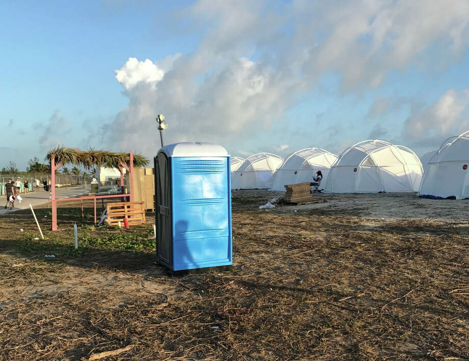 This photo provided by Jake Strang shows tents and a portable toilet set up for the Fyre Festival.Click ahead to see how Twitter reacted to the disastrous music festival. Photo: Jake Strang Via AP / Jake Strang