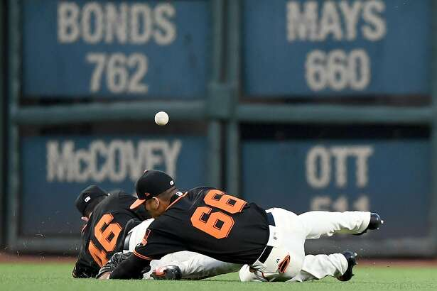 SAN FRANCISCO, CA - APRIL 29:  Drew Stubbs #46 and Gorkys Hernandez #66 of the San Francisco Giants avoid colliding with each other as they go after this ball that goes for an RBI double off the bat of Ryan Schimpf #11 of the San Diego Padres in the top of the six inning at AT&T Park on April 29, 2017 in San Francisco, California.  (Photo by Thearon W. Henderson/Getty Images)