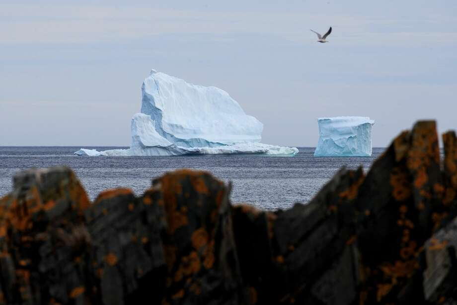 A large iceberg floats in the Atlantic Ocean, April 26, 2017 off the coast of Ferryland, Newfoundland, Canada. Icebergs break off from Baffin Island and Greenland every spring and drift down the stretch of water along the coast of Newfoundland and Labrador known as Iceberg Alley. According to media reports, the higher number of icebergs this season can be attributed to uncommonly strong counter-clockwise winds that draw the icebergs south and possibly global warming, which could be making Greenland's ice sheet melt faster. Photo: Drew Angerer/Getty Images