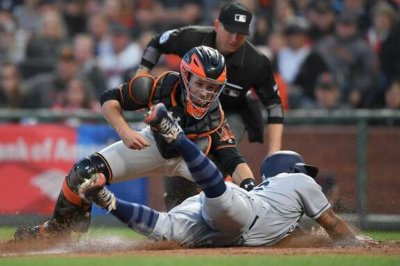 SAN FRANCISCO, CA - APRIL 29:  Buster Posey #28 of the San Francisco Giants tags out Yangervis Solarte #26 of the San Diego Padres at home plate in the top of the six inning at AT&T Park on April 29, 2017 in San Francisco, California.  (Photo by Thearon W. Henderson/Getty Images)