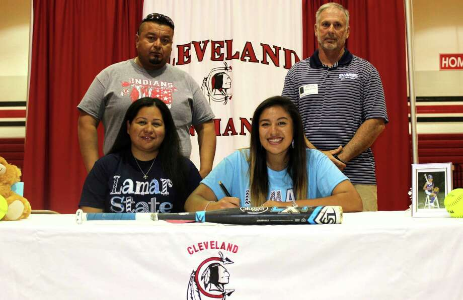 Olivia Rivera, a senior at Cleveland High School, has signed a letter of intent to attend Lamar State College in Port Arthur on a softball scholarship. Pictured with Rivera are her parents, George and Nathalie Rivera, and Lamar State Coach Vance Edwards. Photo: Submitted
