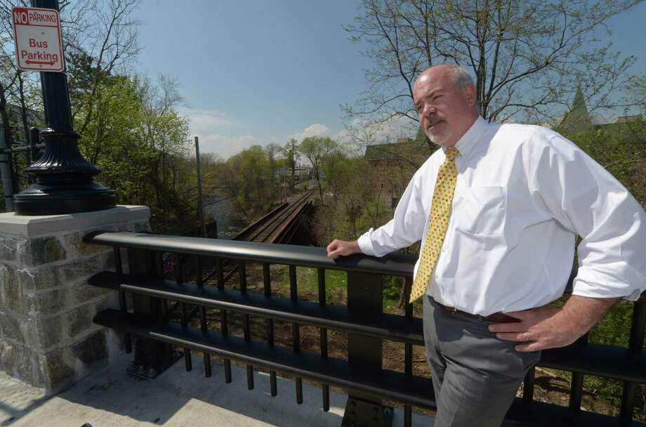 Property owner Michael McGuire speaks on the resurgence of the Wall Street district and the need for a train station in the area along the Burnell Boulevard Bridge Friday, April 28, 2017, in Norwalk, Conn. With Wall Street Theater recently opened, Head of the Harbor South nearing completion, a roof-top bar planned and a nearly completed master plan for Irving C. Freese Park, the long-planned but frustrated effort to bring the neighborhood back from the devestating 1955 flood reached critical mass. Photo: Erik Trautmann / Hearst Connecticut Media / Norwalk Hour