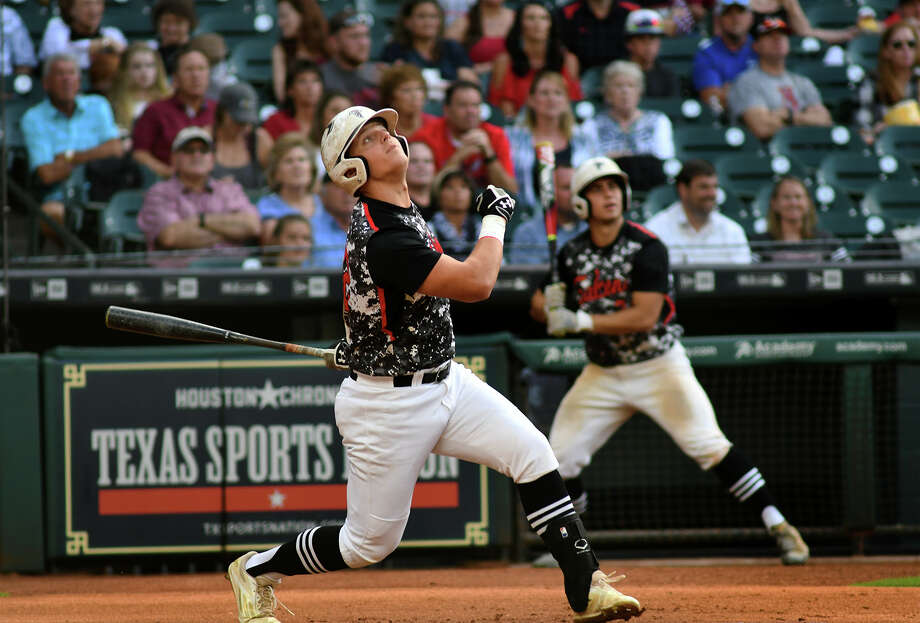 Huffman centerfielder Stephen Keller drives a ball in the top of the 1st inning of their district matchup with Hardin-Jefferson as part of the Houston Astros High School School Baseball Experience at Minute Maid Park on April 24, 2017. (Photo by Jerry Baker/Freelance) Photo: Jerry Baker, Freelance / Freelance
