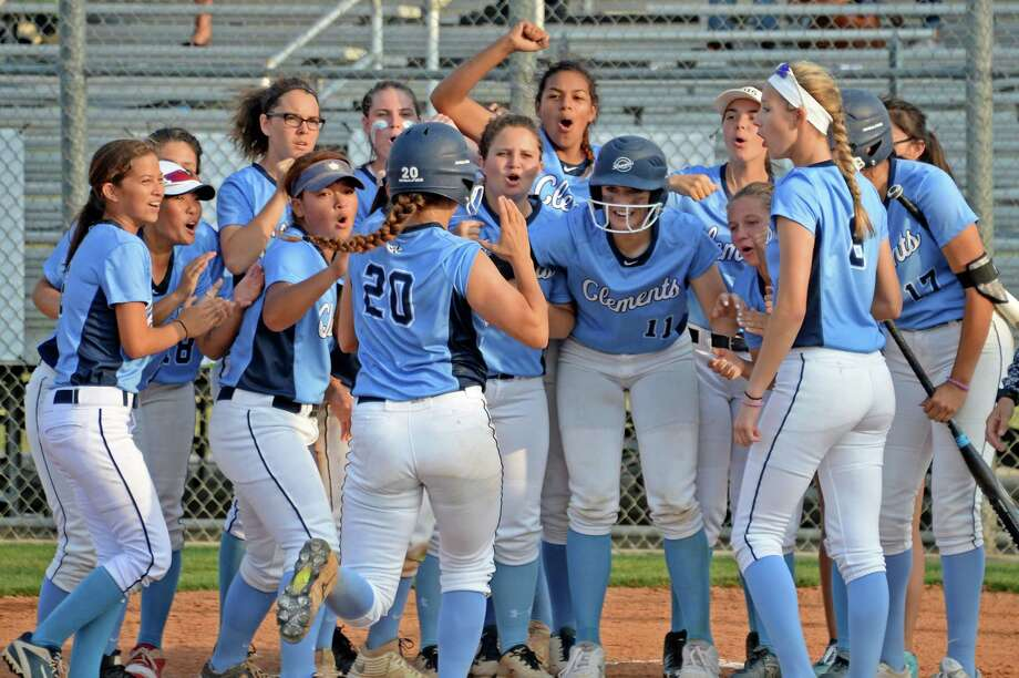 The Clements team celebrates a two-run homer by Miranda Hearn (20) in the third inning of a bi-district playoff softball game between the Seven Lakes Spartans and the Clements Rangers on Friday April 28, 2017 at Seven Lakes HS, Katy, TX. Photo: Craig Moseley, Staff / ©2017 Houston Chronicle