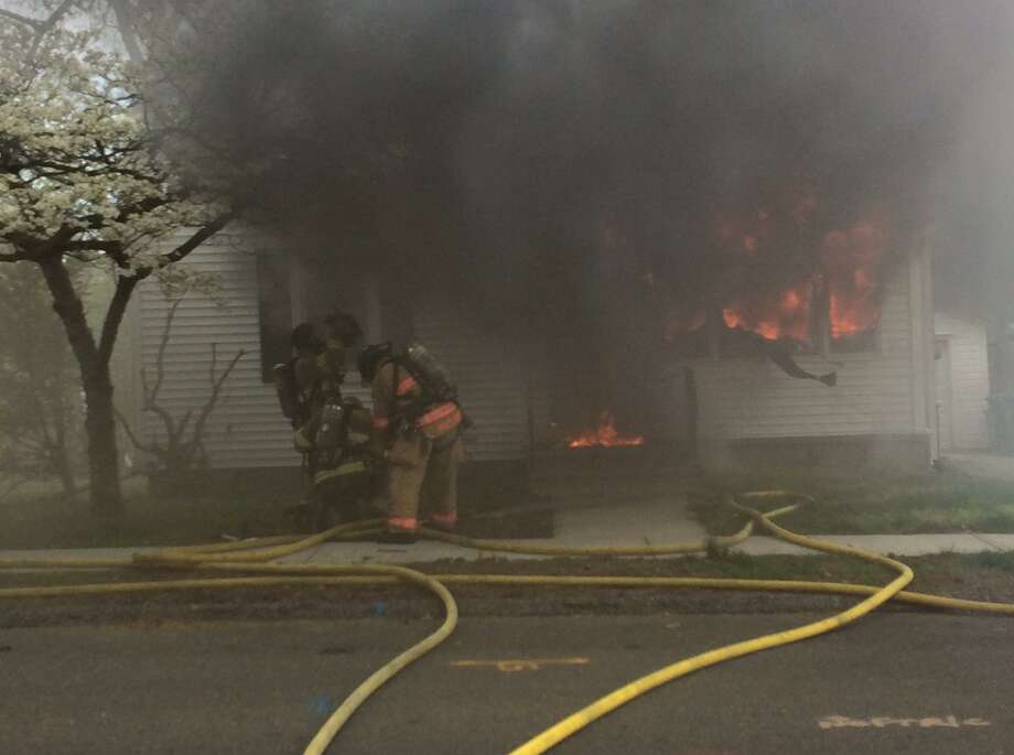 A fire broke out in a one-and-a-half story single family home on Housatonic Drive Sunday morning, badly damaging the building and displacing at least two people. Photo courtesy of the Milford Fire Department. Photo: Contributed / Kyle Brotherton