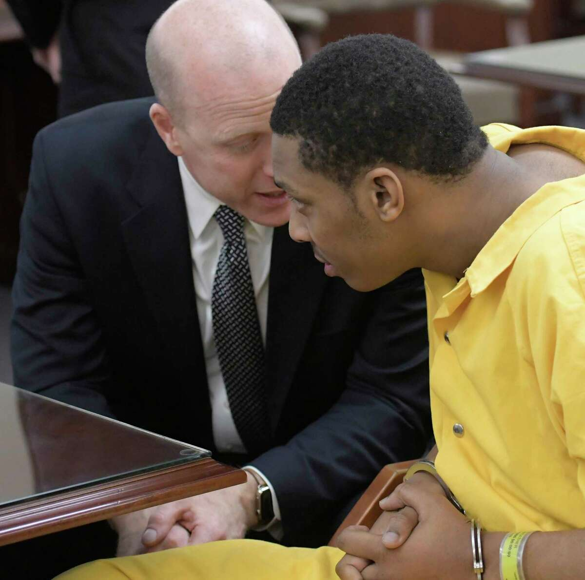 Tasheem Maeweather, right, speaks with his attorney Lee Kindlon Monday Dec. 5, 2016 during his arraignment in Albany County Court in Albany, N.Y. on charges involved with the alleged shooting at Crossgates Mall in November in Albany, N.Y. (Skip Dickstein/Times Union)