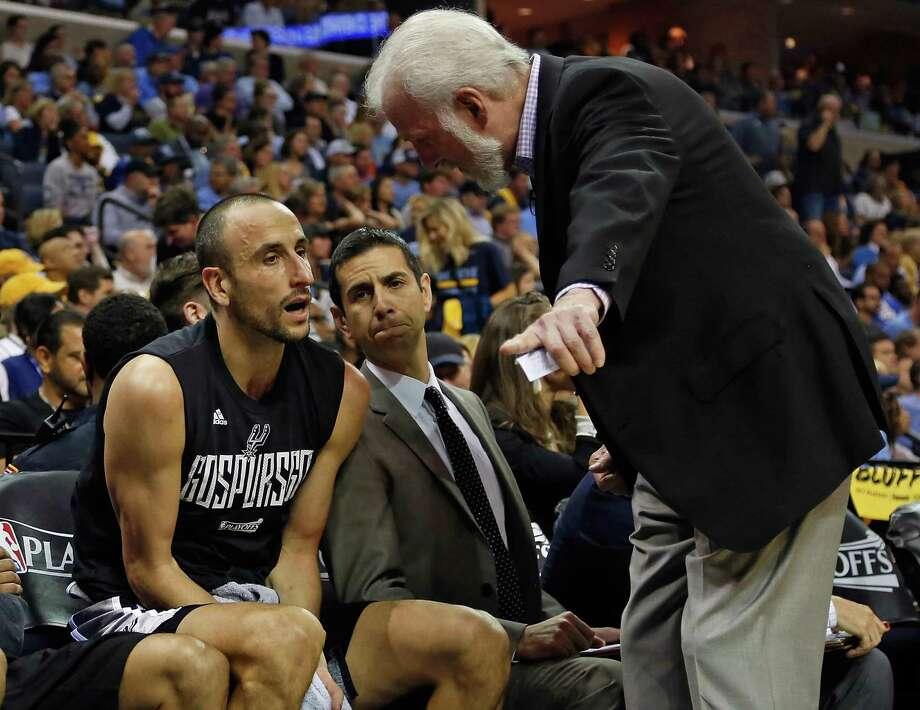 Spurs coach Gregg Popovich talks with Manu Ginobili during the second half of Game 6 against the Grizzlies at FedEx Forum on April 27, 2017 in Memphis, Tenn. Photo: Frederick Breedon /Getty Images / 2017 Getty Images