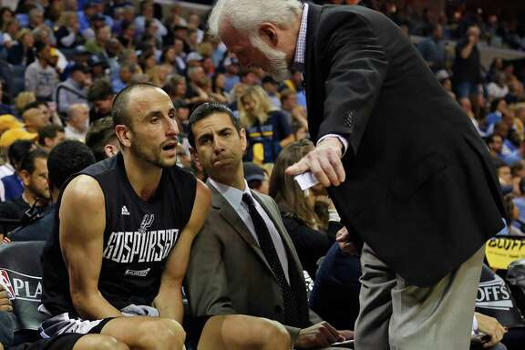 Spurs coach Gregg Popovich talks with Manu Ginobili during the second half of Game 6 against the Grizzlies at FedEx Forum on April 27, 2017 in Memphis, Tenn.