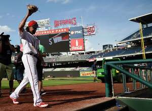 Washington Nationals' Anthony Rendon walks off the field after a baseball game against the New York Mets, Sunday, April 30, 2017, in Washington.  (AP Photo/Nick Wass)