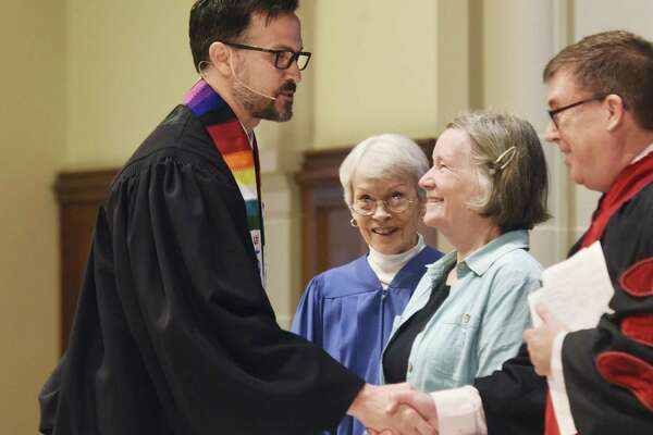 "The Rev. Patrick Collins, left, Associate Pastor for Children, Youth and Families, is congratulated after being installed as a minister at First Congregational Church of Greenwich in Old Greenwich, Conn. Sunday, April 30, 2017. The Rev. Collins has emphasised a ""relational approach,"" which he feels is central to the ministry of the Christian faith."