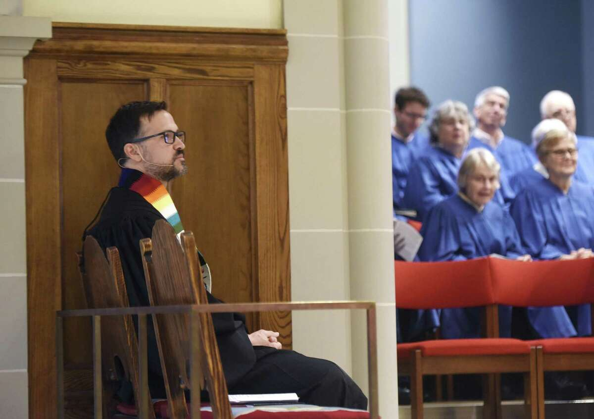 The Rev. Patrick Collins, Associate Pastor for Children, Youth and Families, sits during dervice before being installed as a minister at First Congregational Church of Greenwich in Old Greenwich, Conn. Sunday, April 30, 2017. The Rev. Collins has emphasised a
