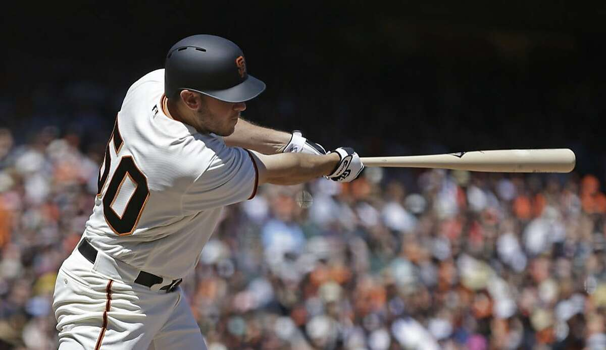 San Francisco Giants' Ty Blach swings for an RBI-sacrifice fly off San Diego Padres' Clayton Richard in the fifth inning of a baseball game Sunday, April 30, 2017, in San Francisco. (AP Photo/Ben Margot)