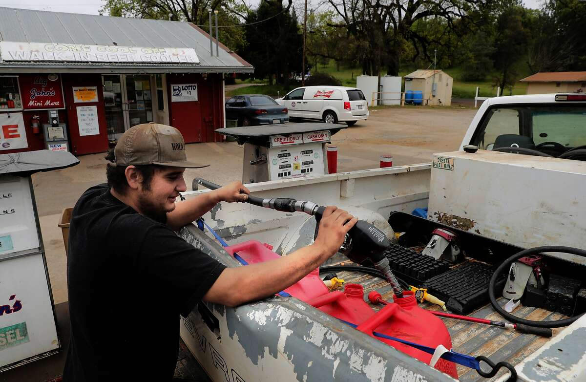 Thomas Godoy who works for a cannabis cultivator, fills up gas cans at Big John's mini mart, to take to the generators that power a cannabis farm in Mountain Ranch, Ca. on Wednesday April 26, 2017.