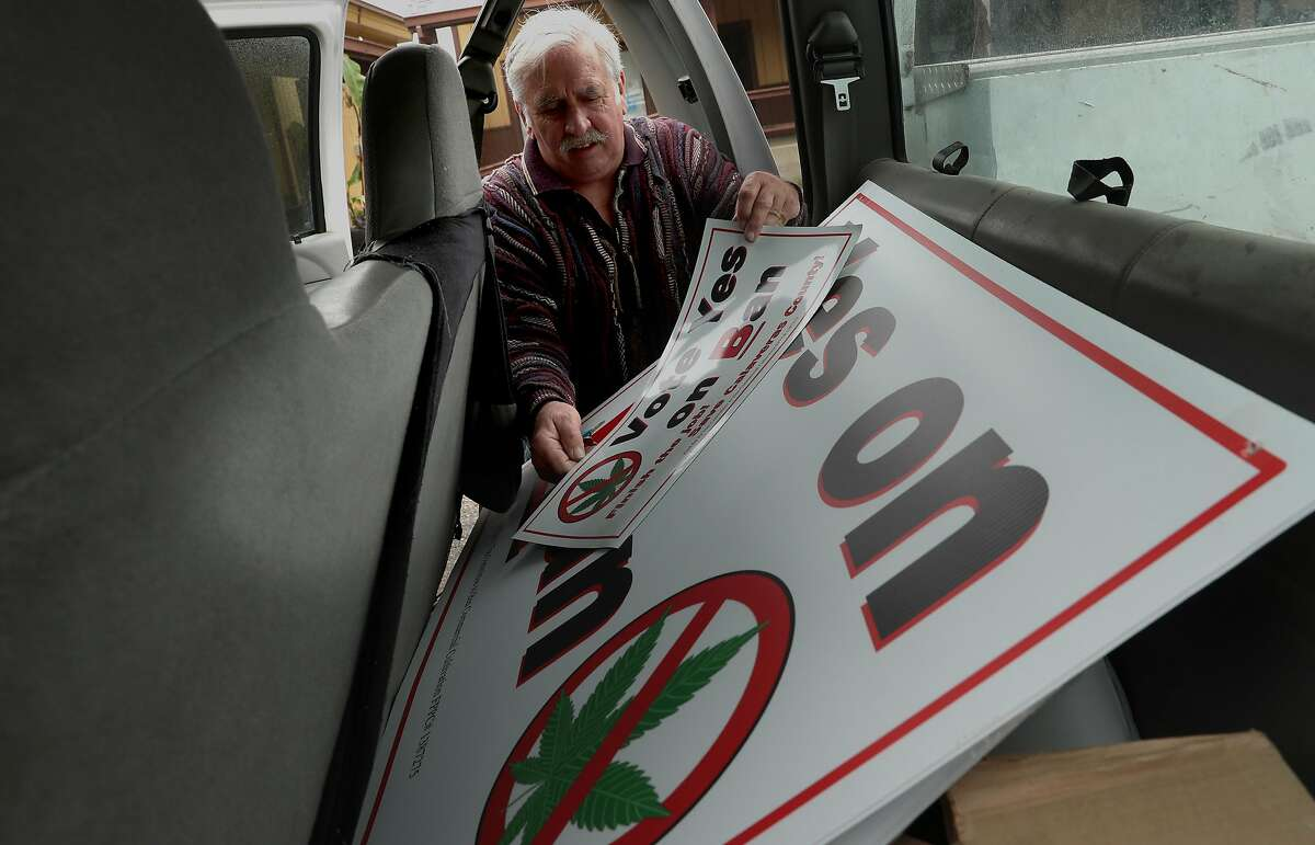 Bill McManus, chairman of The Committee to Ban Commercial Cultivation kept a supply of posters in his pick up truck in support of the Yes on B campaign, he is seen in Mokelumne Hill, Ca. on Wednesday April 26, 2017.