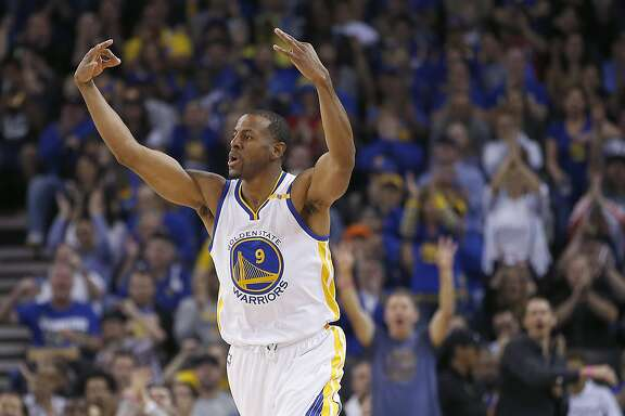 """FILE - In this April 4, 2017, file photo, Golden State Warriors forward Andre Iguodala celebrates a 3-point shot against the Minnesota Timberwolves during the first half of an NBA basketball game in Oakland, Calif. Iguodala is part of """"The Others,"""" Golden State's tight-knit group of non-superstars. The Backups. (AP Photo/Tony Avelar, File)"""