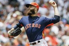 HOUSTON, TX - APRIL 30:  Dallas Keuchel #60 of the Houston Astros pitches in the first inning against the Oakland Athletics at Minute Maid Park on April 30, 2017 in Houston, Texas.  (Photo by Bob Levey/Getty Images)