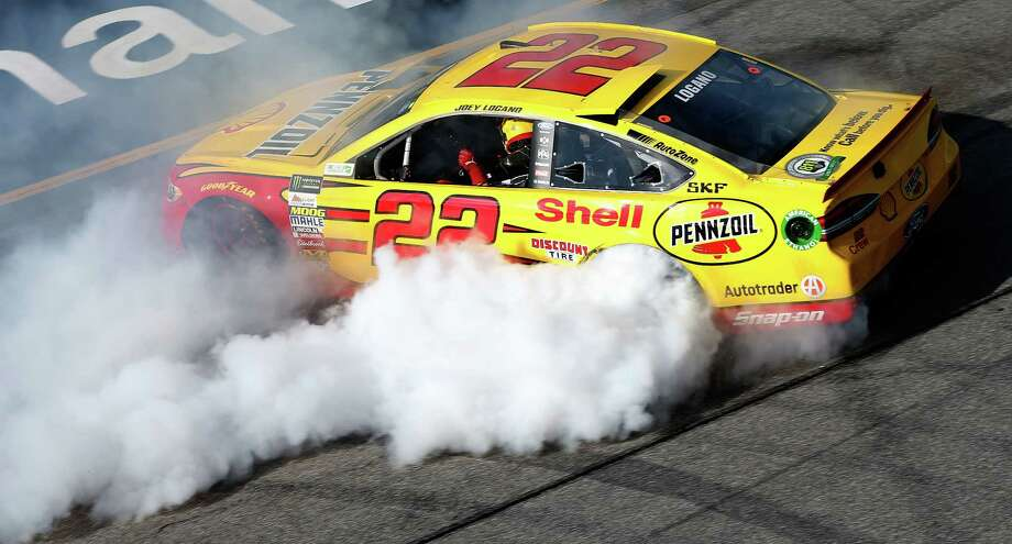 RICHMOND, VA - APRIL 30:  Joey Logano, driver of the #22 Shell Pennzoil Ford, celebrates after winning the Monster Energy NASCAR Cup Series Toyota Owners 400 at Richmond International Raceway on April 30, 2017 in Richmond, Virginia.  (Photo by Brian Lawdermilk/Getty Images) Photo: Brian Lawdermilk, Stringer / 2017 Getty Images