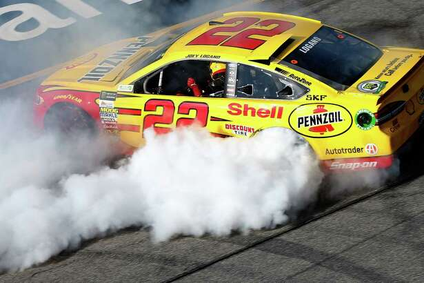 RICHMOND, VA - APRIL 30:  Joey Logano, driver of the #22 Shell Pennzoil Ford, celebrates after winning the Monster Energy NASCAR Cup Series Toyota Owners 400 at Richmond International Raceway on April 30, 2017 in Richmond, Virginia.  (Photo by Brian Lawdermilk/Getty Images)