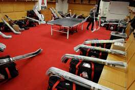 Albany Devils players, Scott Wedgewood, left, and Vojtech Mozik, right, pack up their gear inside the locker room at the Times Union Center on Sunday, April 30, 2017, in Albany, N.Y.     (Paul Buckowski / Times Union)