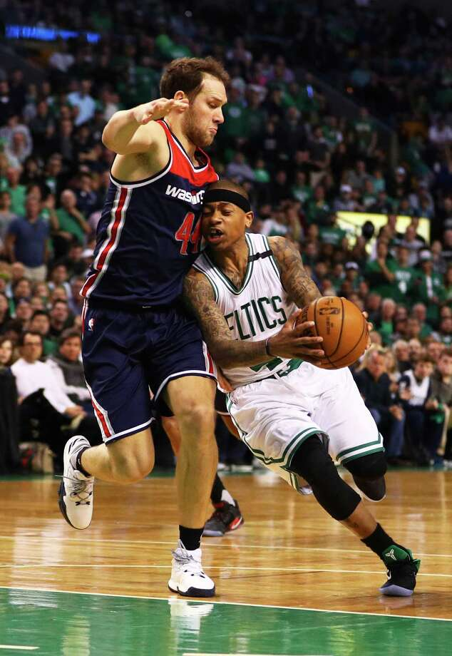 BOSTON, MA - APRIL 30: Isaiah Thomas #4 of the Boston Celtics drives against Bojan Bogdanovic #44 of the Washington Wizards during the fourth quarter of Game One of the Eastern Conference Semifinals at TD Garden on April 30, 2017 in Boston, Massachusetts. The Cetics defeat the Wizards 123-111. NOTE TO USER: User expressly acknowledges and agrees that, by downloading and or using this Photograph, user is consenting to the terms and conditions of the Getty Images License Agreement. (Photo by Maddie Meyer/Getty Images) ORG XMIT: 700042454 Photo: Maddie Meyer / 2017 Getty Images