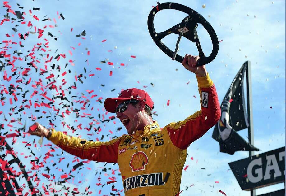RICHMOND, VA - APRIL 30:  Joey Logano, driver of the #22 Shell Pennzoil Ford, celebrates in Victory Lane after winning the Monster Energy NASCAR Cup Series Toyota Owners 400 at Richmond International Raceway on April 30, 2017 in Richmond, Virginia.  (Photo by Jared C. Tilton/Getty Images) ORG XMIT: 700041417 Photo: Jared C. Tilton / 2017 Getty Images