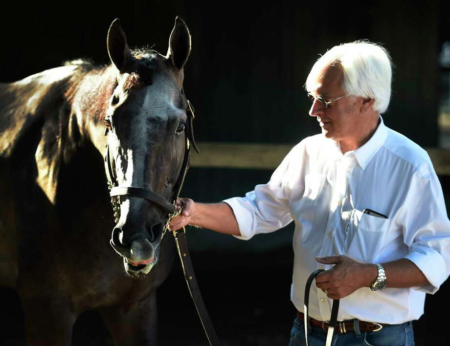 Trainer Bob Baffert has a quiet moment with Travers Stakes winner Arrogate Sunday morning in the barn area at the Saratoga Race Course August 28, 2016 in Saratoga Springs, N.Y.    (Skip Dickstein/Times Union) Photo: SKIP DICKSTEIN