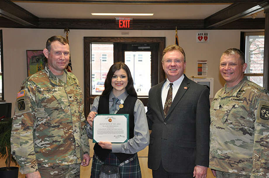 Edinboro University Ally Crowley-Duncan of Latham holds the citation that came along with the the Department of the Army Commander?s Award for Public Service for her performances as the Edinboro University ROTC battalion bagpiper.